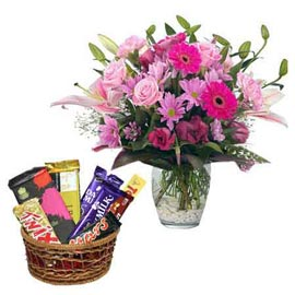 gift Online Pink lilies in Vase n Assorted Chocolates in cane Basket