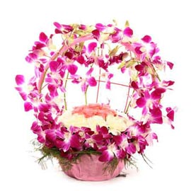 buy White carnations orchids n Pink roses Basket 24 hrs Delivery