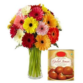 Send Online Gulab Jamun pack n mix gerberas in Vase