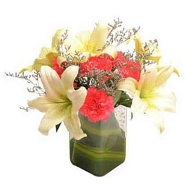 Send White lilies and Red carnations glass Vase 24 hrs Delivery