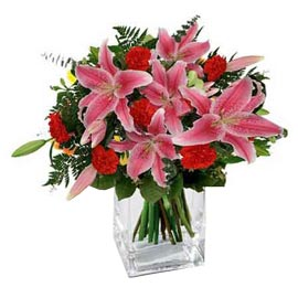 buy lilies n carnations glass Vase Midnight Delivery