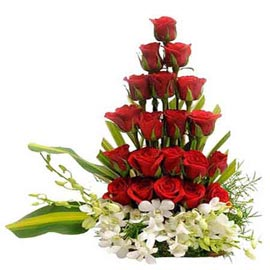 Send mix roses n orchids designer Basket Midnight Delivery