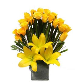 Send Yellow mix flowers glass Vase Xpress Delivery