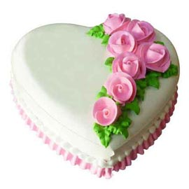 xpress Delivery of 1 Kg Vanilla floral Heart Cake